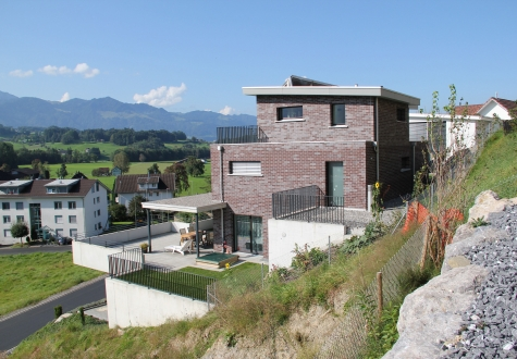 Studie Variante moderne Architektur Familie Garten Bauleitung Planung Kaltbrunn Ronner Küche nachts Licht Beleuchtung Innenarchitketur Design